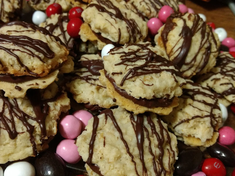 Chocolate ganache sandwich cookies with red and pink M&Ms