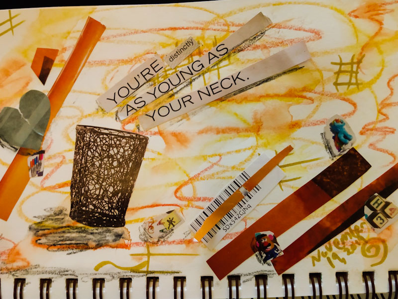 Collage with watercolor crayons and magazine text